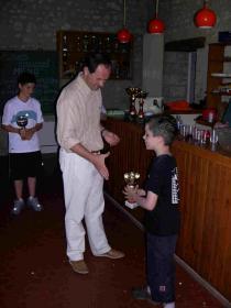 Mr le Maire remet une coupe à Alban pour ses performances dans le tournoi scolaire de Rebréchien